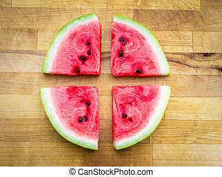Watermelon slices arranged in a circle shape, fresh fruit...