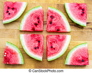 Watermelon slices arranged in a circle shape and around,...