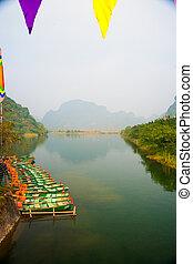 Trang An Grottoes - Many wooden boats near Trang An...