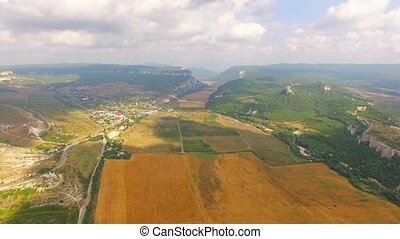 Birds Eye View Of Hilly Locality And Harvest Field - PAN:...