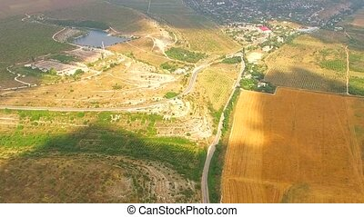 Bird's Eye Panorama Of Hilly Locality And Harvest Field -...