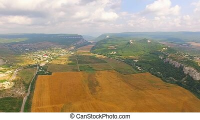 Bird's Eye Scenery Of Hilly Locality And Harvest Field