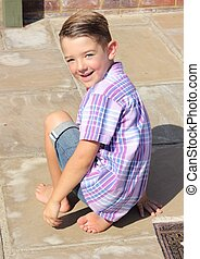 Handsome boy - A handsome young boy sitting on the floor...