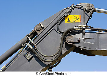 Excavator hydraulics - Close-up of the hydraulic tubes and...