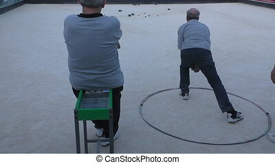 Malta island,seniors play boule - Malta island Rear view of...