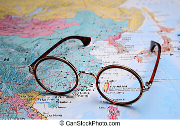 Glasses on a map of Asia - Taibei