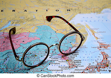 Glasses on a map of Asia - Beijing