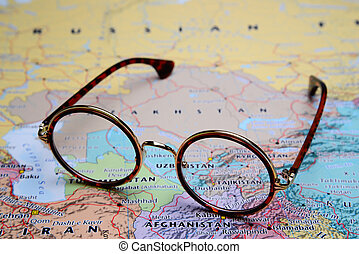 Glasses on Asian map - Tajikistan - Photo of glasses on a...