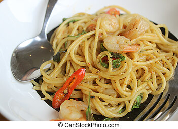 Stir-fried spicy spaghetti with shrimp, also known as...