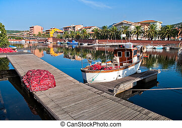 Fishing boats and nets on the river in Bosa in Sardinia