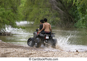 Quad Bike - Quad bike ATV is a couple of young riders having...