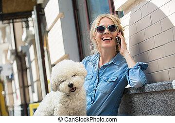 Cute blonde with Bichon Frise white dog - Cute blonde in...