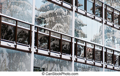 winter frontpiece of the building with reflections of the...