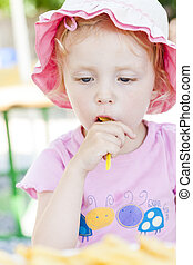 little girl eating chips