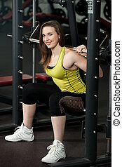 Girl in powerlifting squat position lifts weights - Girl in...