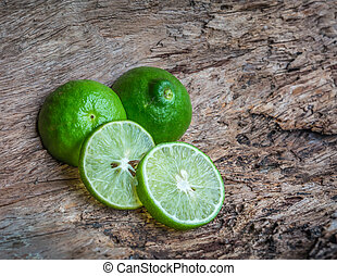green lime on wooden background, insect repellent--ants and...