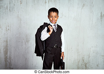 First time at school - Smiling black first-grader african...