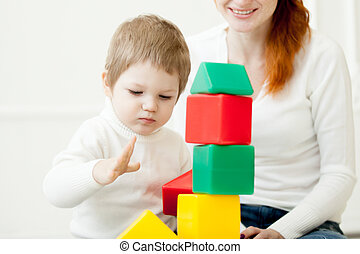 Baby playing with colorful toy blocks - Little baby playing...