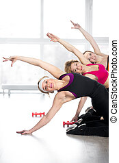 Group of women doing fitness training in class - Fitness...