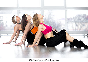 Group of three women have fitness practice in class
