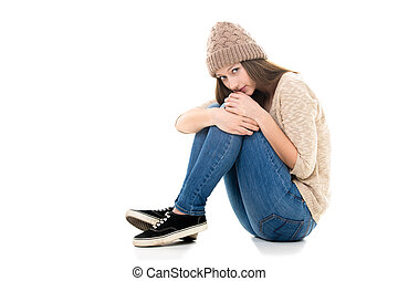 Scared teenage girl curled-up - Teens troubles. Unhappy...