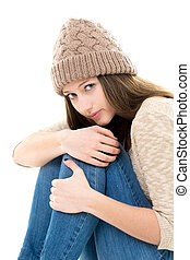 Frightened teenage girl curled-up - Teens troubles....