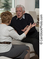 Elderly couple arguing - Aged copule is falling out and...