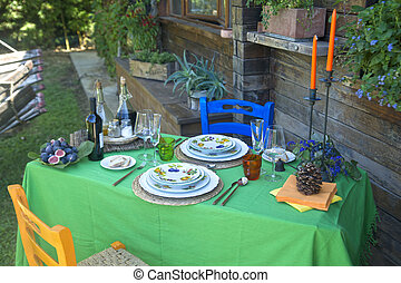 Outdoor dining table - Set table outdoors in rustic setting...