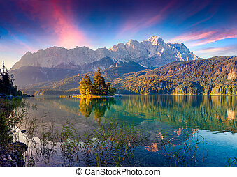 Colorful summer sunrise on the Eibsee lake in German Alps....