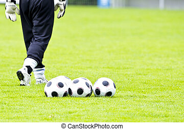 Goalkeeper with Balls - A Goalkeeper with five Footballs