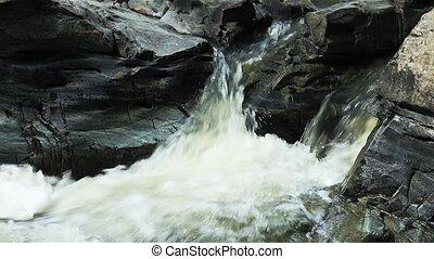 Mountain stream between stones