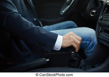 Hand of the driver on manual gear shift knob