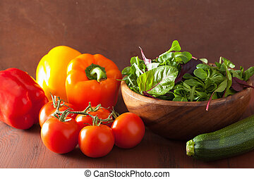 healthy vegetables pepper tomato salad zucchini on rustic background