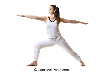 Yoga Pose Warrior 2 - Beautiful fitness model practices yoga...