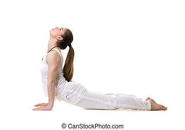Yoga upward facing dog pose - Young fitness model in white...