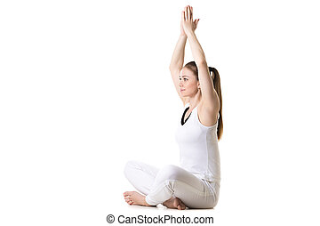Yoga pose sukhasana - Portrait of young beautiful girl in...