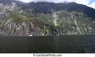 MilCruise boat in Milford Sound, New Zealand - MILFORD...
