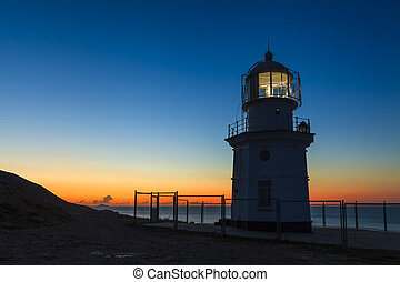 Glowing lighthouse against the beautiful night scenery