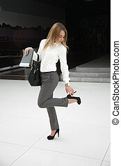 Tight shoes - Beautiful young woman in office style white...