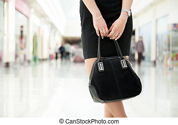 Young woman with suede bag, close up - Attractive young...