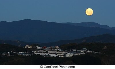 moon rising - Moon rising at night over Wellington New...