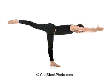 Yoga Pose Warrior 3 - Sporty young man practicing yoga,...