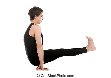 Floating Stick asana - Sporty young man doing yoga or...
