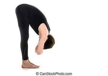Uttanasana, Elbow Grab - Profile of sporty young man on...