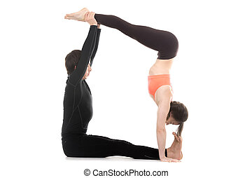 Acroyoga, handstand - Sporty couple on white background...