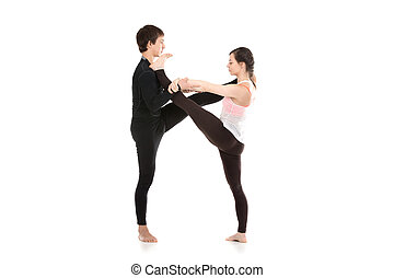 Acro yoga extended hand-to-big-toe pose - Two sporty people...