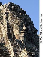 Smiling face of Jayavarman VII in the temple of Bayon,...