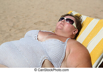 overweight woman on beach