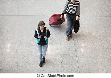Girl travelling - Young smiling woman in late 20s walking...