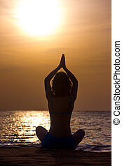 Asana Sukhasana - Silhouette of serene young woman...